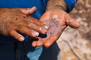 Man working with clay