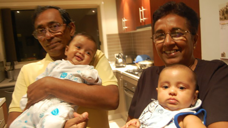 Pushpa Jayakody with husband Jaya both holding babies