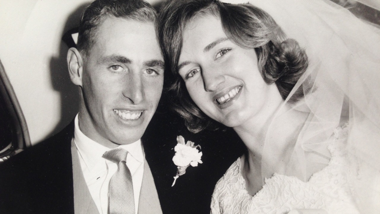 Sepia photograph of smiling young couple on their wedding day